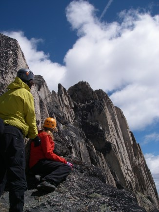 As we eat lunch, another team rock climbing up the face of Eastpost tops out on the true summit.