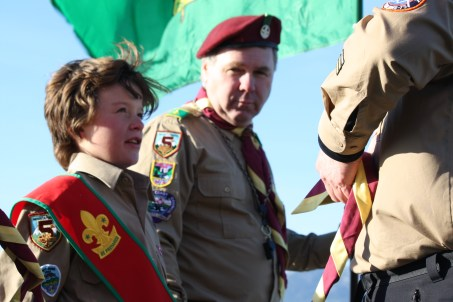 The older generation watches with approval as a younger generation starts his life as a Scout.