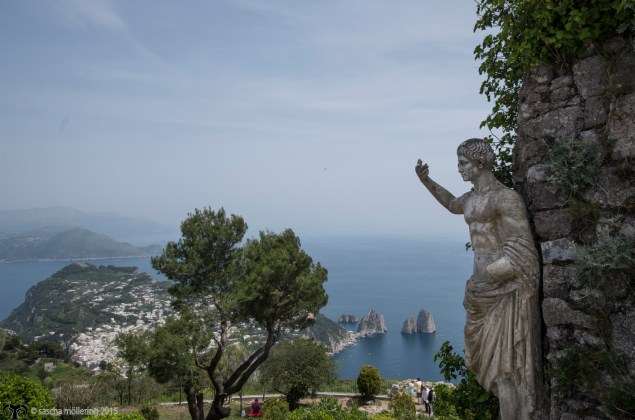 On top a mountain on Capri, roman statue holds vigil.