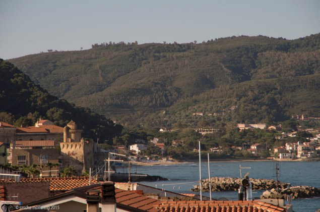 The coast at Santa Maria di Castellabate with an old palazzo and tower guarding the harbour.