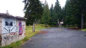 Basketball court in an abandoned army barracks in Zabljak, the skull grafitti is presumably the regiment's symbol.
