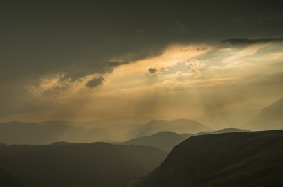 Rain clouds break open over the peaks surrounding the high plane in Durmitor national park