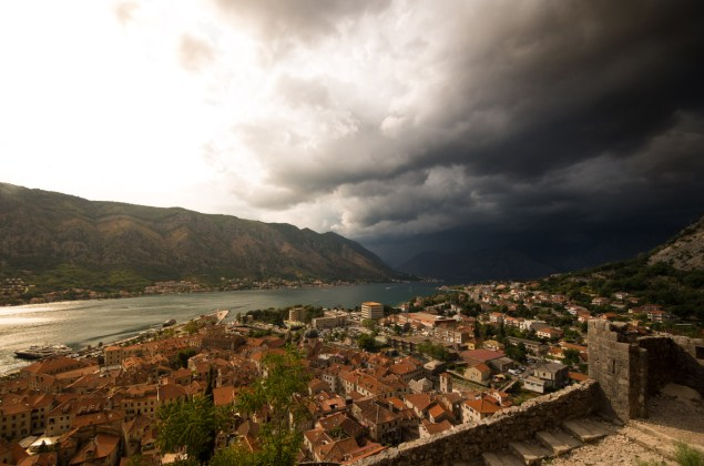 An approaching thunderstorm seperates the bay of Kotor in light- and darkness