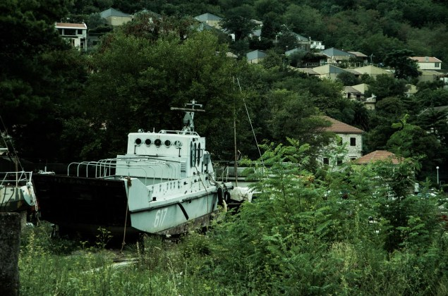 An abandoned military landing craft rots away on the outskirts of the town of Kotor.