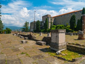 Remnants of the Roman Basilica atop the hill of San Giusto with the medieval fortress of Trieste in the background