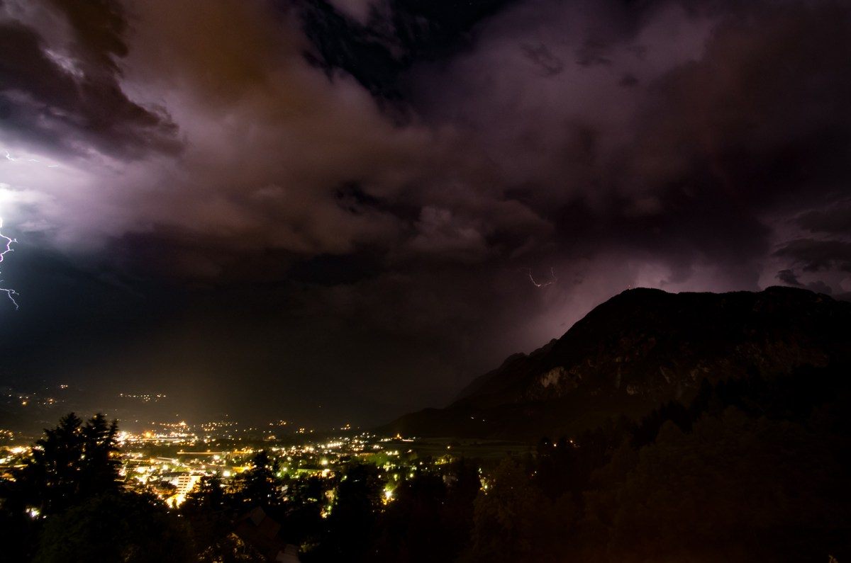 lightning over nighttime Lienz valley in the Austrian Alps.