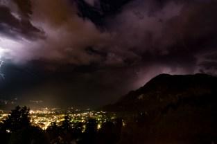 lightning over nighttime Lienz valley in the Austrian Alps.
