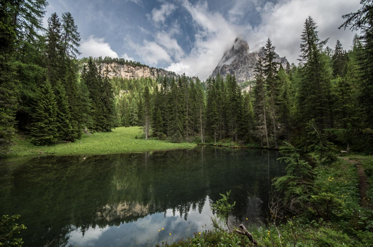 Mountains reflected in a small lake in the Dolomites