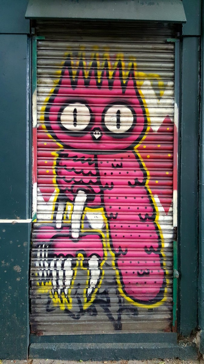Street art in London, Eastend: mural of an owl by artist Dcreet.