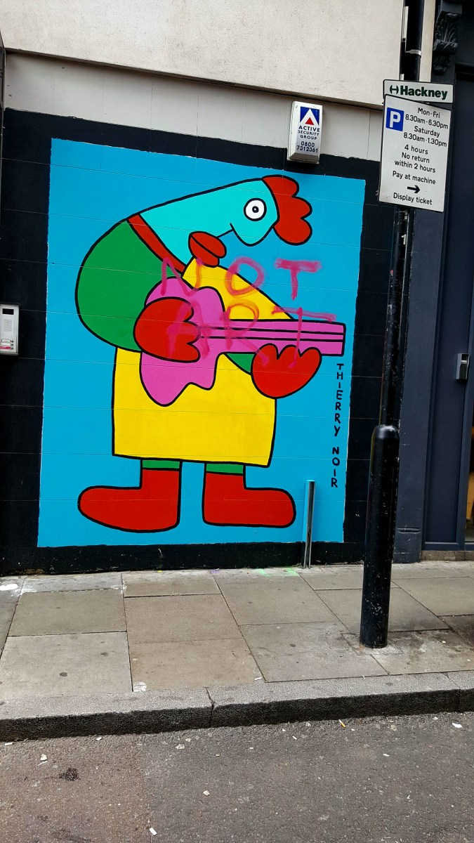 Guitar player by Thierry Noir on a wall in London