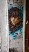 Srteet art in London: portrait of a young woman by c215