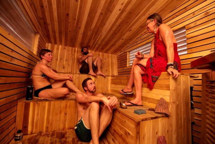 Margie Weaver and other sauna society folk enjoying a cozy January evening at Little Box Sauna.