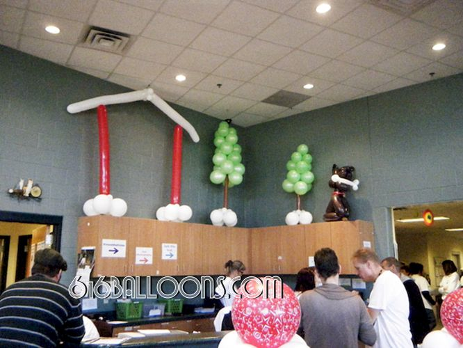 Balloon Dog with bone, trees & house scene balloon sculpture by 616Balloons.com Grand Rapids, Mi. Premium balloon art & decor. Corporate events, private parties..