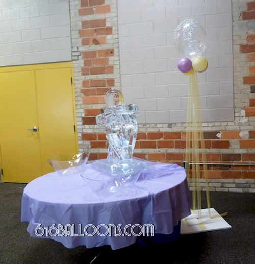 Elegant column with balloons and tulle for baby shower by 616Balloons.com Grand Rapids, Michigan. Specializing in high end balloon art & decor for the best corporate or private parties and events in West Michigan.