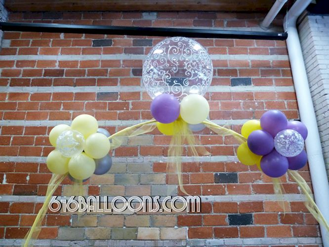 Elegant floral table arch close up of balloons and tulle for baby shower by 616Balloons.com Grand Rapids, Michigan. Specializing in high end balloon art & decor for the best corporate or private parties and events in West Michigan.