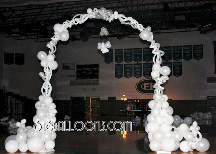 Angel arch by 616 Balloons Grand Rapids, Mi. Premium balloon art & decor. Corporate events, private parties..