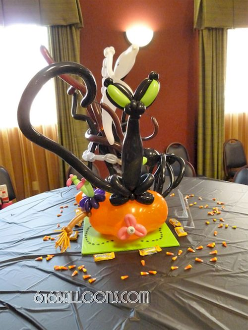 Halloween centerpiece cat on pumpkin balloon sculpture by 616Balloons.com Grand Rapids, Mi. Premium balloon art & decor. Corporate events, private parties..