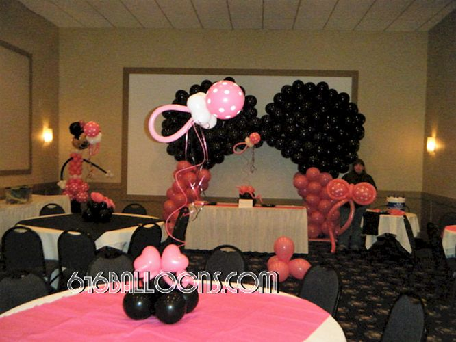Minnie Mouse themed balloon arch columns and pacifier centerpieces for baby shower by 616Balloons.com Grand Rapids, Michigan. Specializing in high end balloon art & decor for the best corporate or private parties and events in West Michigan.