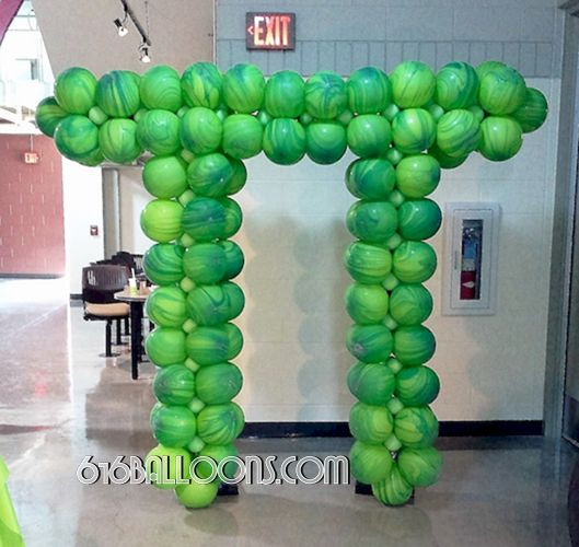 Pi symbol balloon sculpture for Maker Faire at GVSU by 616Balloons.com Grand Rapids, Mi. Premium balloon art & decor. Corporate events, private parties..