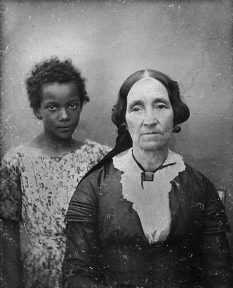 photo of a Woman with slave girl in the mid 19th century, New Orleans