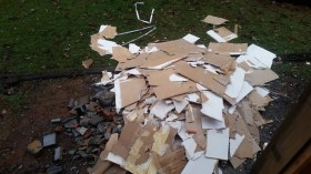 Debris out the back door - ready for dumpster