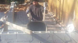 Wheelbarrowing concrete to the back slab