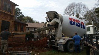 Concrete truck in front yard
