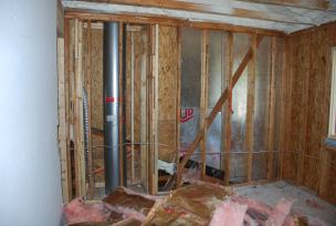 Removing last remains of old insulation and drywall at exterior walls