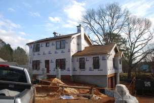 Installing the new roofing shingles