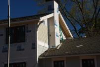 Siding beside chimney with soffit in place