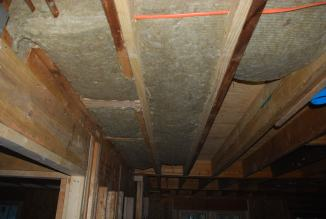 Sound insulation encapsulating drain pipes above Family Room