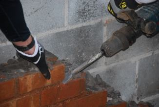 Hammer drilling - one brick at a time