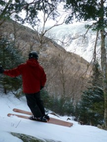 Vin contemplating the beauty Of the notch and his line on his first pair of ski ever built. Still in use the Three Eighteen.07 model