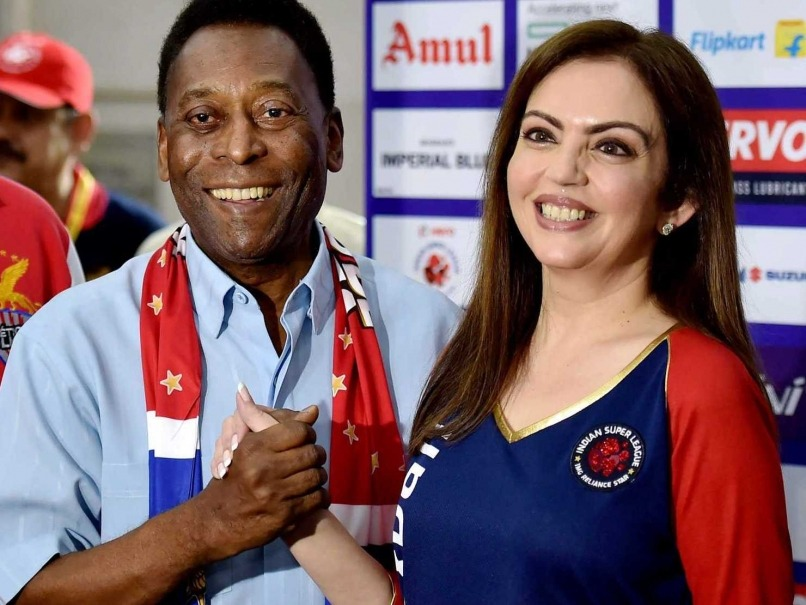 Nita Ambani taking a selfie with her Brazilian chauffeur and tour guide at the Olympics.