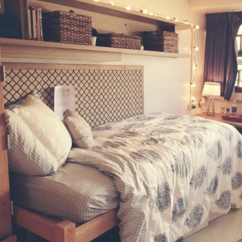 Patterned Comforter and Rustic Wooden Shelves on Clique Tips