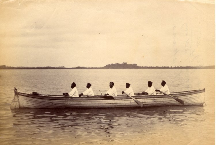 "ukpuru: "" Six oared gig at Mimosa Factory at Bakana, Kalabari people, southeastern Nigeria, turn of the 20th century. Photo: Jonathan Adagogo Green. """