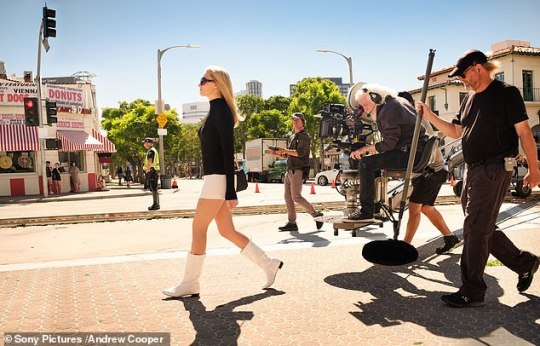 Iconic: Margot Robbie stepped out in go-go boots as slain actress Sharon Tate as she was followed by a film crew