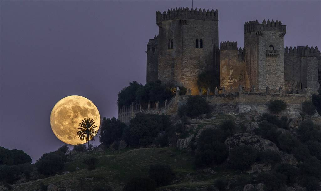 The moon rises behind the castle of Almodovar in Cordoba, southern Spain. Miguel Morenatti