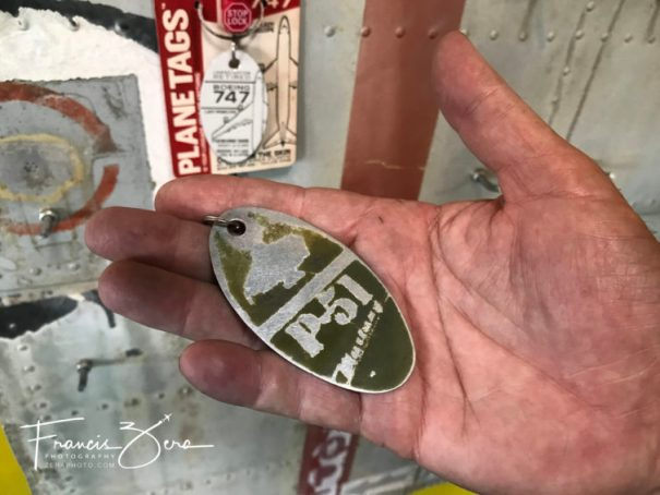 Dave Hall holds the very first PlaneTag; he used it as a keychain long enough to nearly wear the design completely off the thing.