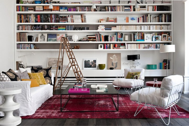 Home Decor Style Eclectic Modern Living Room White Couch Wood Floors Fuchsia Rug White Bookshelves Ladder Lamps Throw Pillows