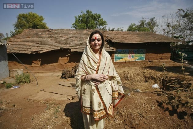 Nita Ambani flying back to her village temple to get Mataji's blessings just before the Taekwondo finale in which she would come first.