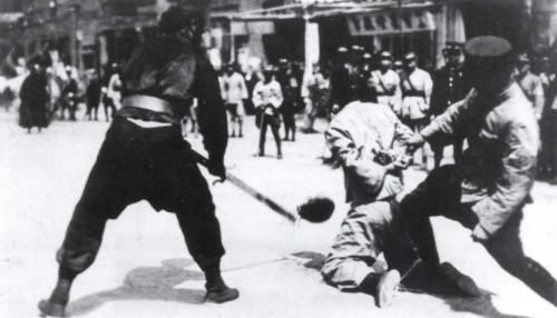 During the Shanghai massacre, KMT sympathizers behead a suspected Communist, one of about 300 executions carried out on April 12th, 1927