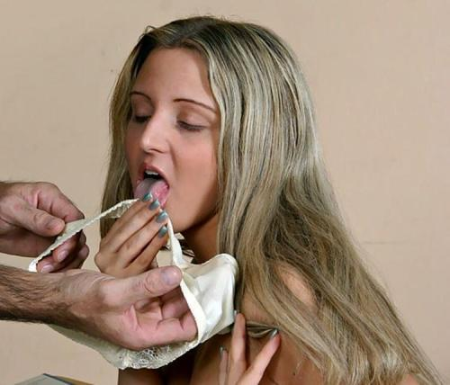 Image of a husband giving diry panty to wife to lick with cum