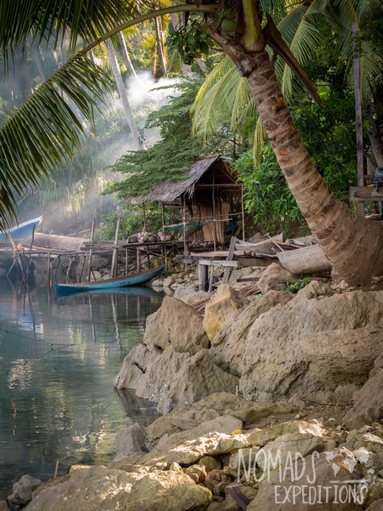 nowhere papua indonesia forest jungle wild wilderness tribal traditional culture travel adventure explore trek discover journey guide wonder dangerous survival village island tropical remote undiscovered water boat hut smoke fire evening