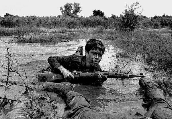 Child soldier in an oil drenched swamp during the iran iraq war child soldier in an oil drenched swamp during the iran iraq war probably in the area of basra 1982 1988 fandeluxe Choice Image