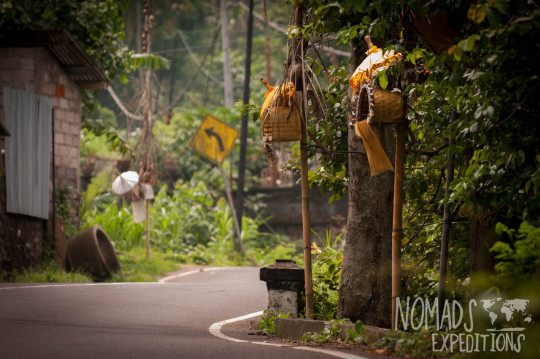 bali indonesia travel adventure culture journey indo pacific explore discover road windy twist bend sign