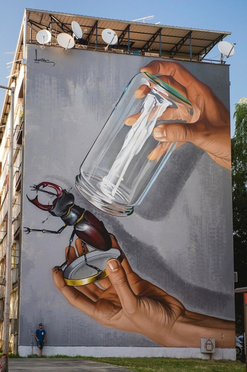 """crossconnectmag:Street Artist: Lonac  Lonac is a muralist, painter, and illustrator from Zagreb, Croatia.  In Croatian, """"lonac"""" means cooking pot. That nickname was given to the artist when he was just a boy, and back then, he hated it. When he started doing graffiti, Lonac had to come up with some tag name for himself. At the time, all the graffiti writers had some cool gangsta nicknames/tags, but every name the young creative came up with sounded fake and pretentious, so he took the one he disliked the most. """"Thinking about the beginnings really amuses me. It doesn't take too long to remember the feeling of child-like excitement and freedom I get while painting outside. It's easy to do it when you're a kid, but as people grow older they stop doing some of the things that made them happy."""" Follow him on Instagram and Facebook.Stay current with Cross Connect Magazine on Twitter and Facebook.posted by Margaret via"""