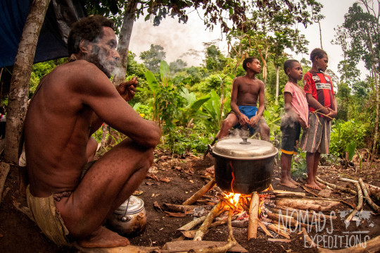nowhere papua indonesia forest jungle wild wilderness tribal traditional culture travel adventure explore trek discover journey guide wonder dangerous survival village island tropical remote undiscovered kids man cooking food fire pot