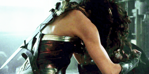 Wonder Woman shatters a rifle.