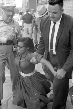 In this image civil rights activist Patricia Due is being arrested by Tallahassee Police along with 260 FAMU students for protesting in front of the segregated Florida Theater, May 30, 1963.